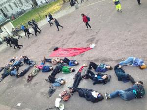 """Students spelling out """"NO FEES"""" in the UCL Main Quad."""